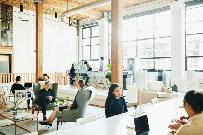 Businesspeople working in coworking office space