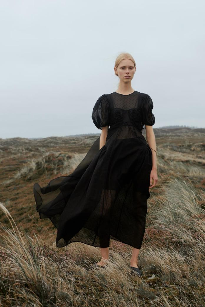 Cecilie Bahnsen sends her women on a journey inspired by nature, unity and hope through a moody and sensuous Spring/Summer 2021 collection. This standout look from the collection consists of an organza overlay layered with a plumetis organdie black gown.