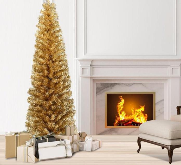 gold christmas tree next to a white fireplace