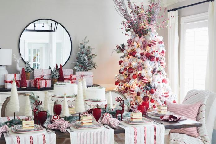 A Christmas tree and decorated holiday table