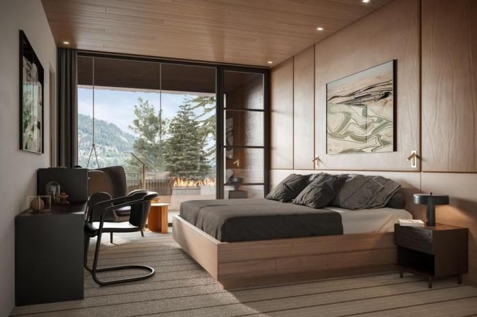 Elegant bedroom with view of mountains