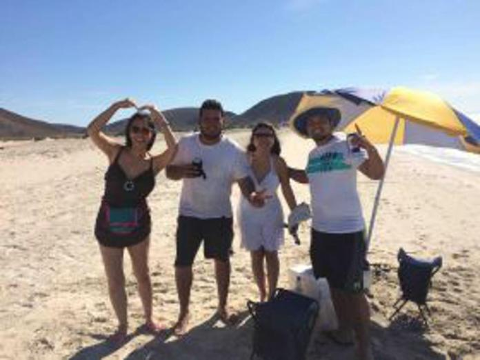 Jet Metier at the beach in Mexico with friendly locals