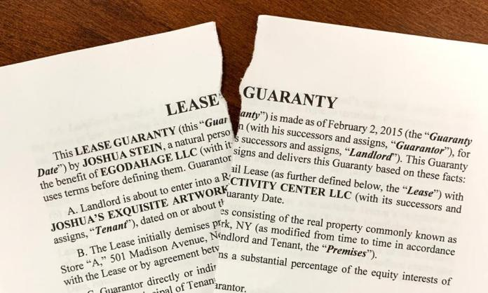A guaranty document, torn in half.