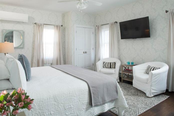 Bedroom interior with wallpaper and wood floor