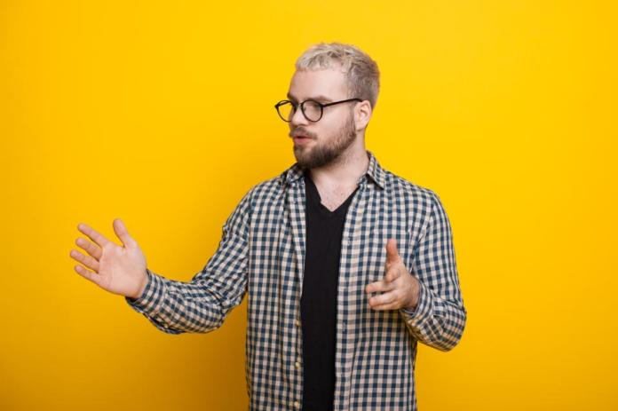 A yellow accent wall can work well for video or Zoom backgrounds.