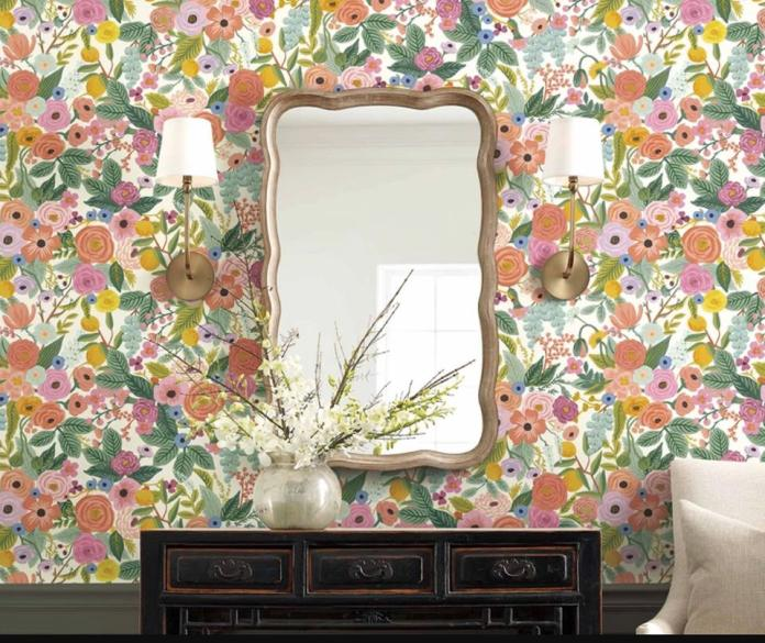 rifle paper co flower print wallpaper by a mirror over a dresser