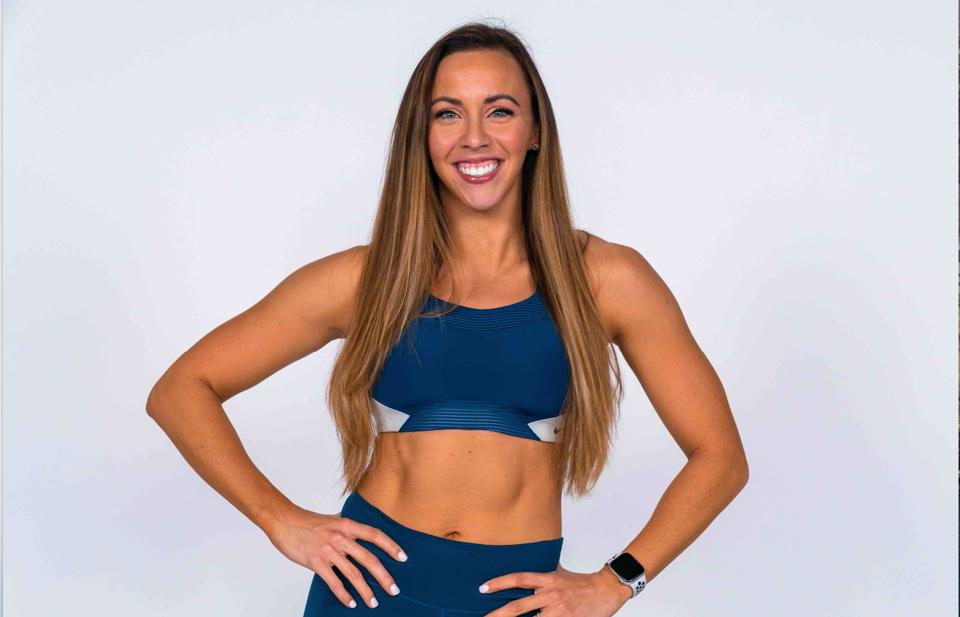 Headshot of Cummings in a blue workout outfit.