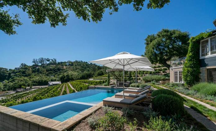A pool overlooks coffee orchards.