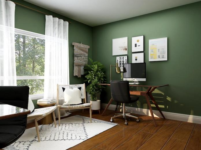 a home office in a green room
