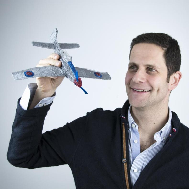 3Doodler Co-Founder and CEO Daniel Cowen holds a plane made with a 3D pen.