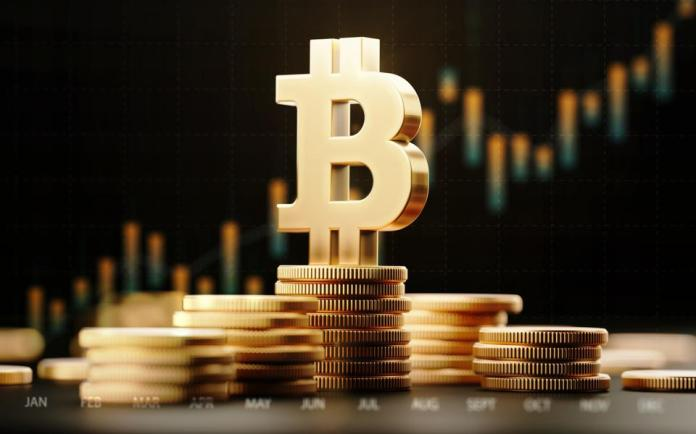 A picture of bitcoin, a digital currency, on top of some coins.
