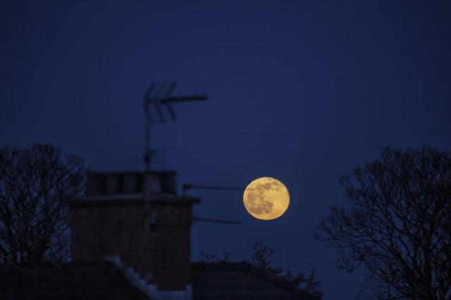 The full ″Snow Moon″ rising over Cardiff, Wales, on Saturday, February 27, 2021.