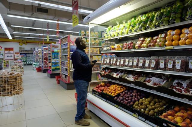A man shops for fresh fruit in a supermarket in Entebbe, Uganda.