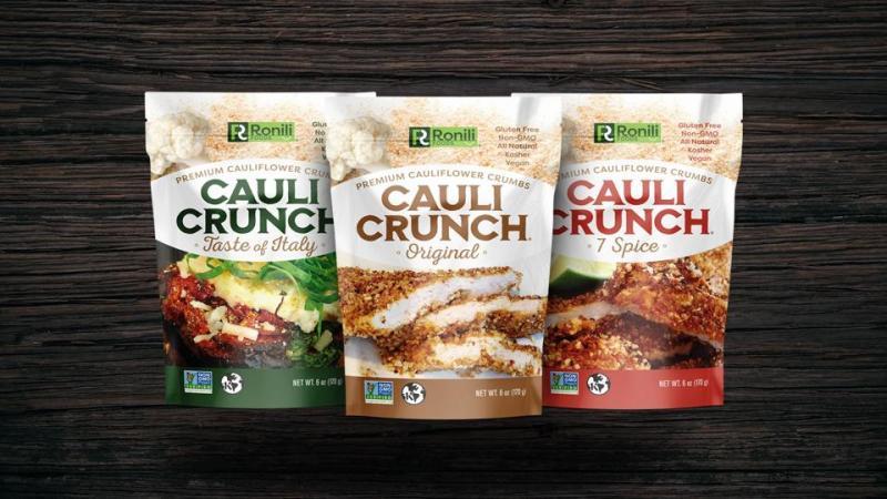 Three flavors of Cauli Crunch on a wood background