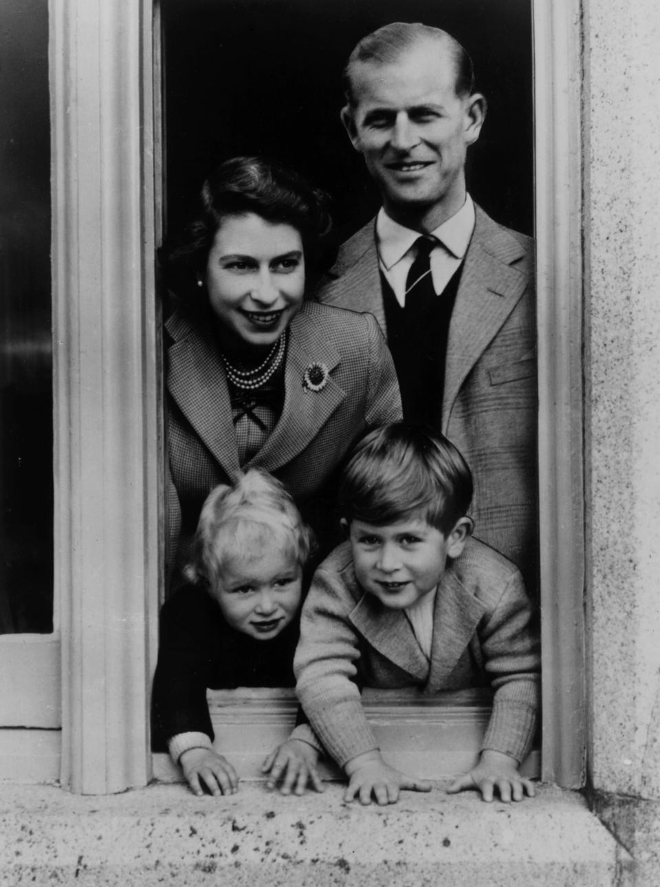 Queen Elizabeth, Prince Philip, and their children, Charles and Anne 1952