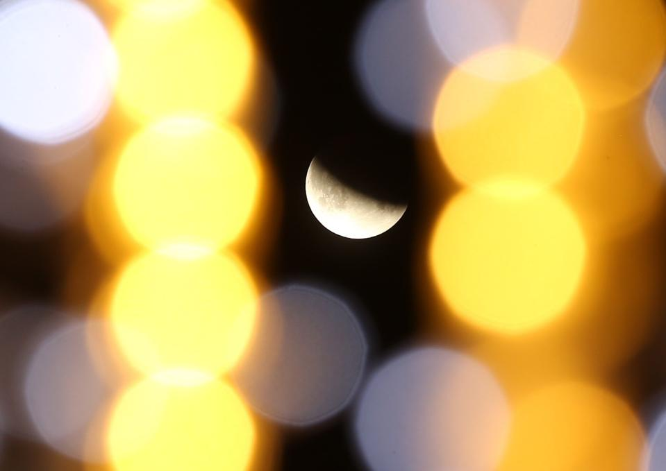 The shape of the edge of Earth's shadow was used to estimate the ratio between the Moon and the Earth radii. Here's the Partial Lunar Eclipse is seen in Sakarya, Turkey on July 17, 2019. (Photo by Ibrahim Yozoglu/Anadolu Agency/Getty Images)