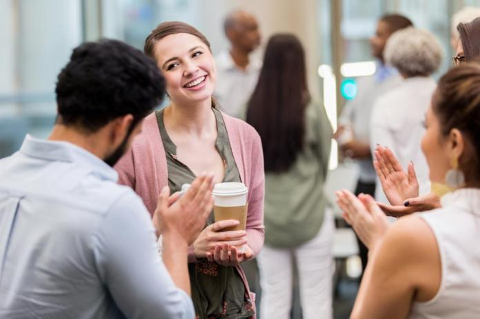 Businesspeople Applaud Colleague