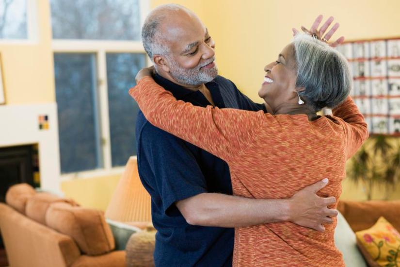 African american couple dancing in the living room