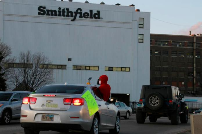 On April 9, employees and family members demonstrated outside a large processing plant at Smithfield Foods in South Dakota that has experienced an outbreak of coronavirus.