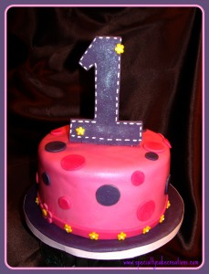 Pink and Purple First Birthday Cake