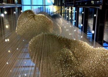 30 METRE GLASS SCULPTURE LIT BY SILL LED PROJECTORS