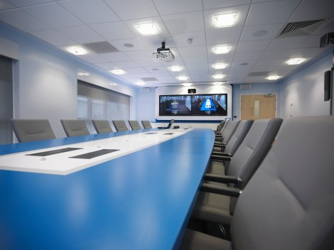 Blue boardroom table & media wall
