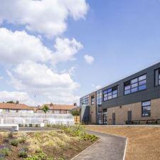 Derelict football stadium transformed into school