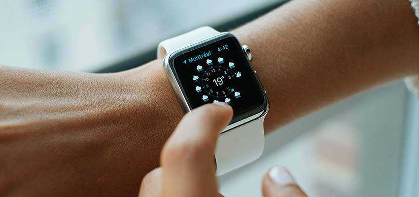 Person checking their smart watch.
