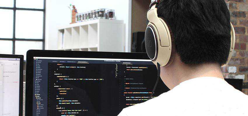 A man writing code.
