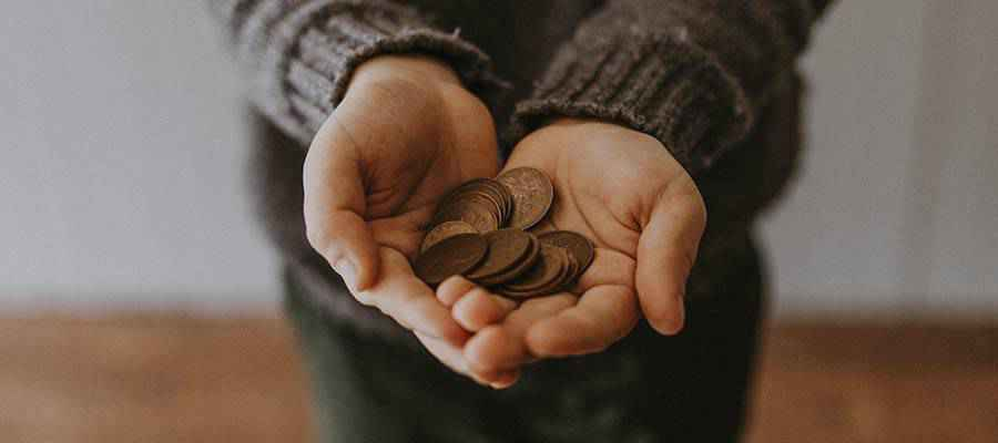 A person holding coins.