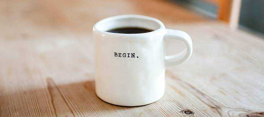"A coffee mug with ""BEGIN"" written on it."