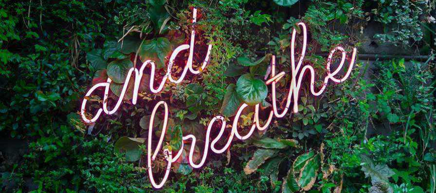 A sign that reads: And Breathe.