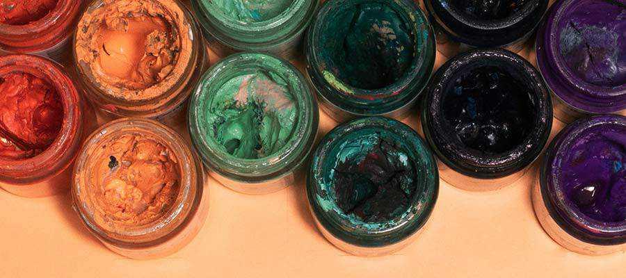 Paint jars on a table.