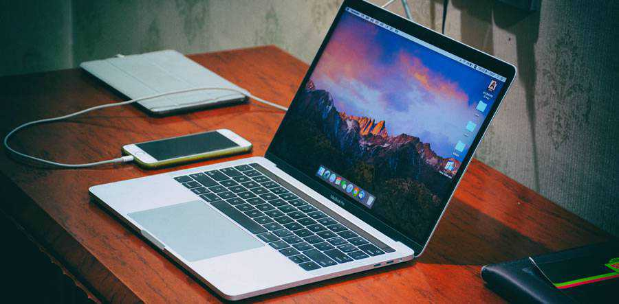macbook pro laptop on desktop designer