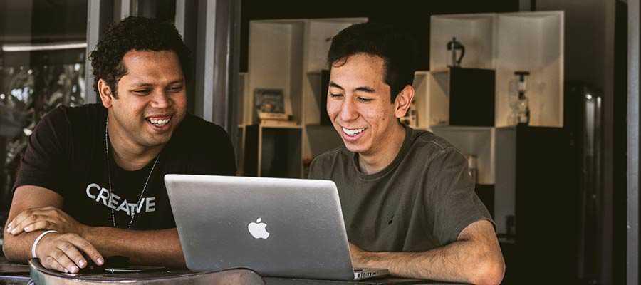 Two men viewing a computer screen.