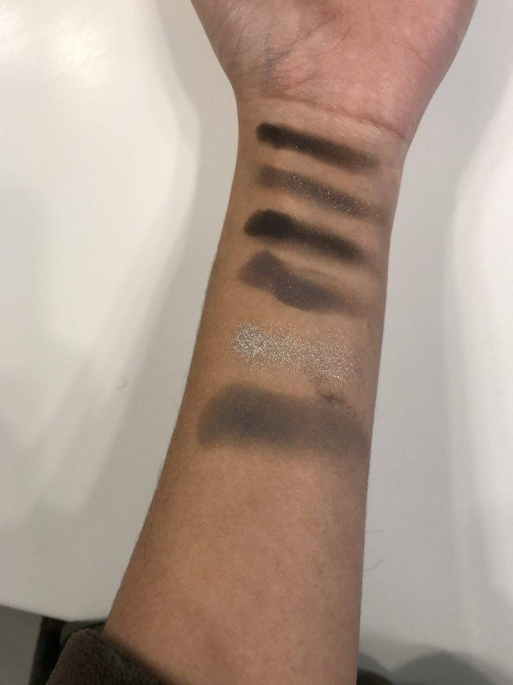swatches across the hand from the colourpop eyeshadow palette: smoke show