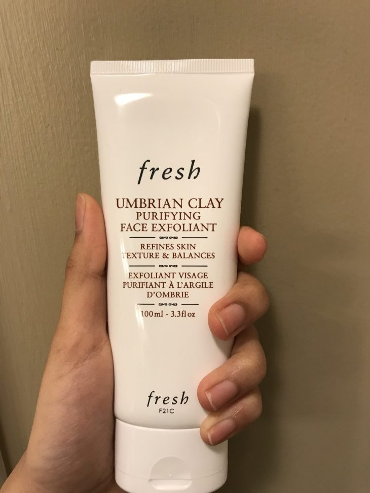 girl holding the fresh Umbrian Clay Purfiying Face exfoliant