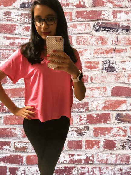girl wearing hot pink top from Alice + Olivia