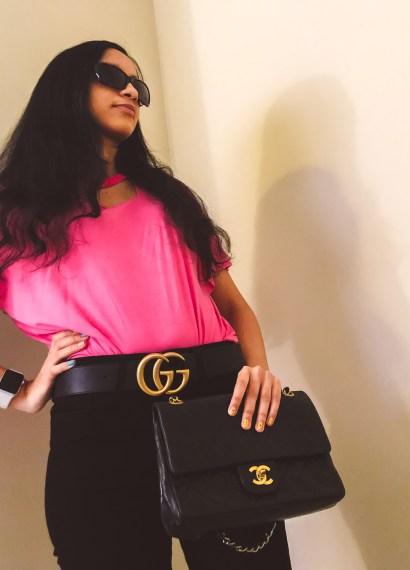 girl holding chanel bag wearing designer clothing