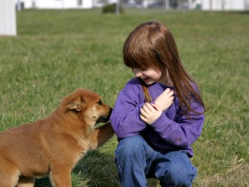 A child and a dog. To illustrate debate on the Causes of autism - links with c sections?