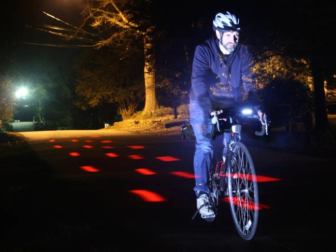 Photo of the author cycling at night.