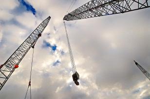 Crane booms in the sky