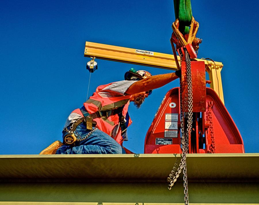 Ironworker Setting Up the Hook to Lift a Bridge Beam for The Downtown Span of the Ohio River Bridges Project. #1