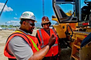 Michael Arnold, Safety Manager, and Monique Jones, Operating Engineer, have a laugh together.