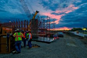 Ironworker from Ironworkers Local 70 gather their tools to start work on a section of steel girders being installed along I-71 in Louisville KY