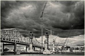 Storm clouds gather over the Indiana shore of the Ohio River and the Downtown Crossing construction for the Ohio River Bridges Project. #4 (B&W Version)