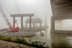 A foggy morning as the crew boat navigates alongside Pier Seven of the Downtown Span on the Ohio River Bridges Project in Louisville, Kentucky.