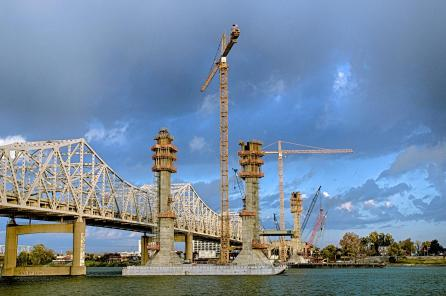 Early morning on the Ohio River Bridges Project Downtown Span construction site showing Towers 4 and 5 in front of the Kennedy Bridge in Louisville, Kentucky.
