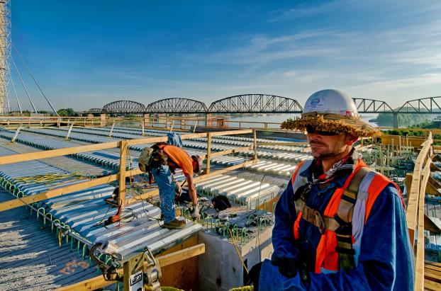Aaron Donnell, Ironworker Local 798 and Matthew Pike, Ironworker Local 70 install steel deck panels.