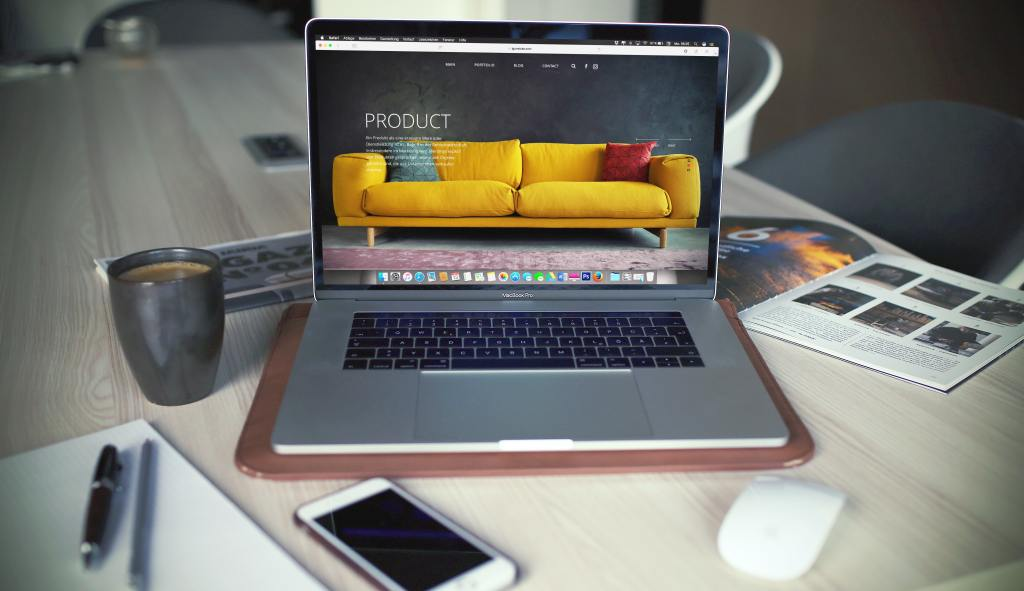 Laptop on desk with image of yellow couch WordPress Design